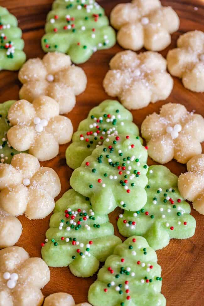green and white Spritz cookies on a wood board