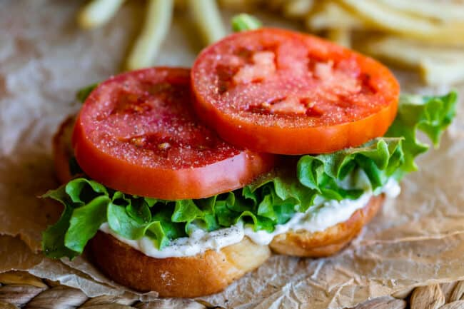 white bread, mayonnaise, lettuce, and tomato sandwich