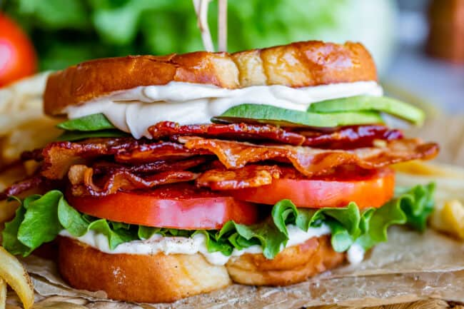 BLT sandwich with mayo, lettuce, tomato, bacon, and avocado