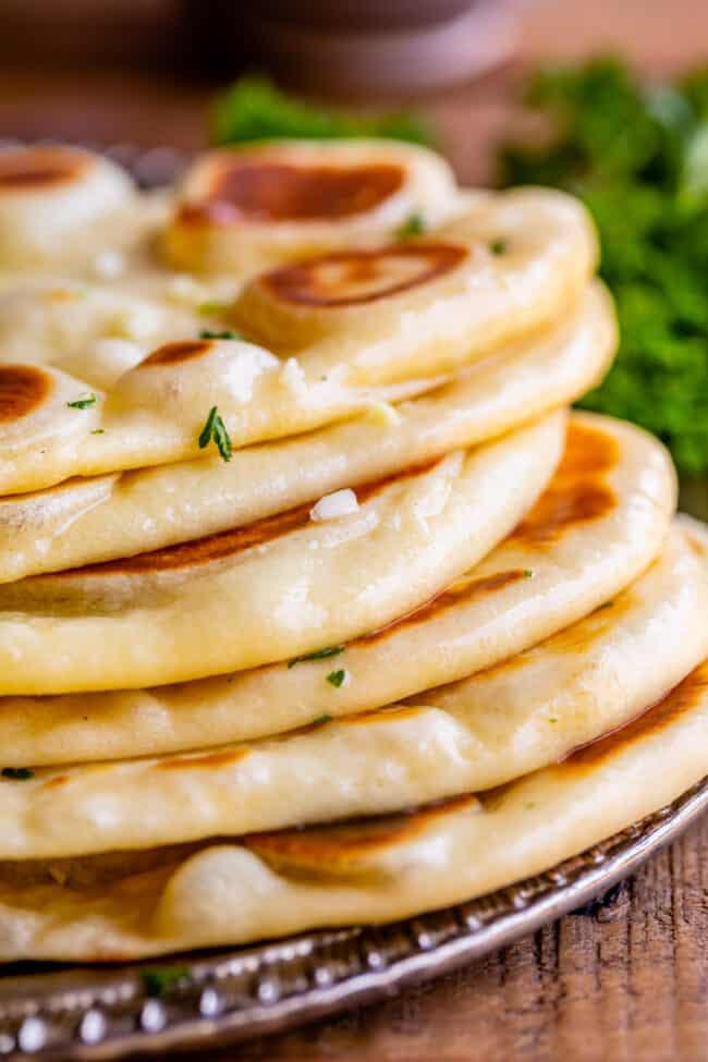 naan bread recipe, stacked on a plate