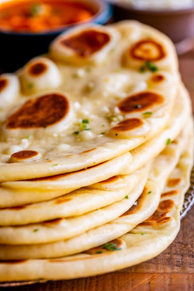 easy naan recipe, stacked up on a plate