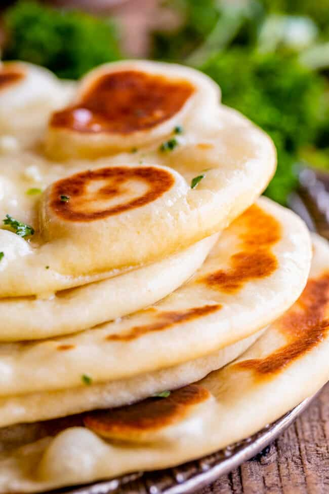 what is naan bread, stacked up on a plate