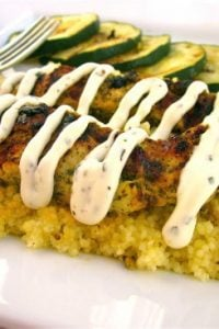Pesto Chicken with Italian Cream Sauce over Parmesan Couscous from TheFoodCharlatan.com