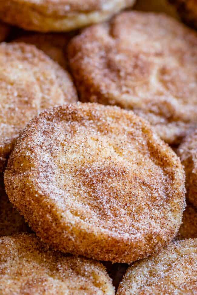 how to make snickerdoodles soft and chewy, stacked on a pan