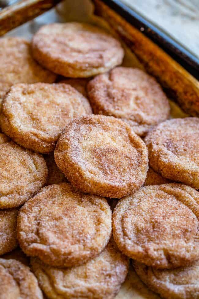 snickerdoodle cookies spread out on a pan