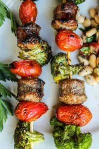 Easy Sausage and Broccoli Kebabs with White Bean Salad from TheFoodCharlatan.com