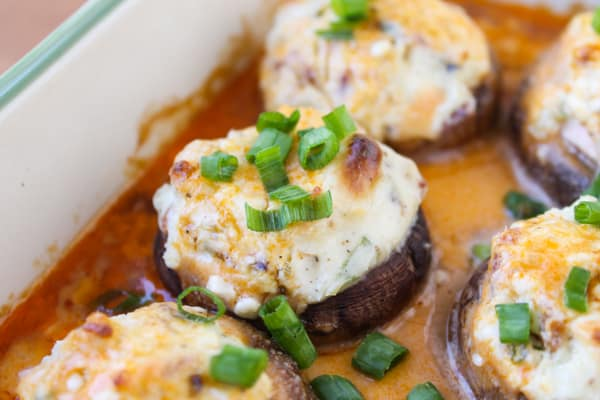 Bacon Blue Cheese Stuffed Mushrooms with Creamy Hot Sauce | TheFoodCharlatan.com // These are perfect (and easy!) appetizers for football watching!