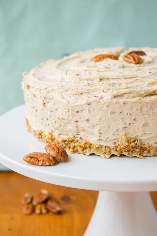 Cinnamon Cardamom Cake with Maple Pecan Frosting on cake stand