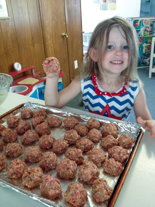 Charlotte making meatballs - she's cute, but meatballs?