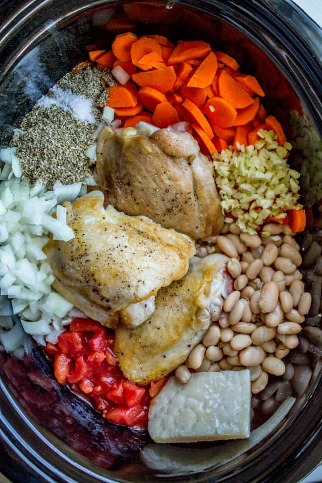 Prepped chicken, beans, cheese, and veggies in crockpot
