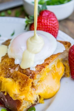 Grilled Cheese Eggs Benedict with Bacon and Hollandaise Sauce from The Food Charlatan