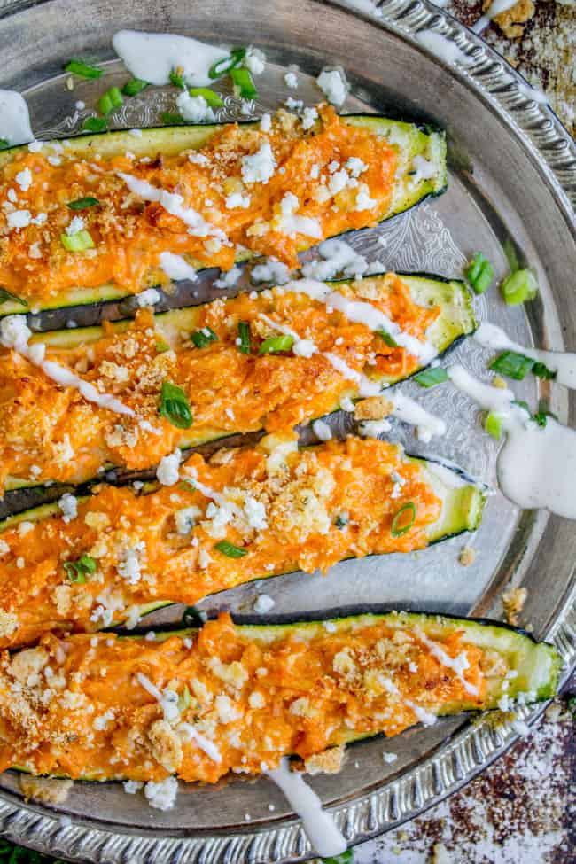 Buffalo Chicken Zucchini Boats from The Food Charlatan