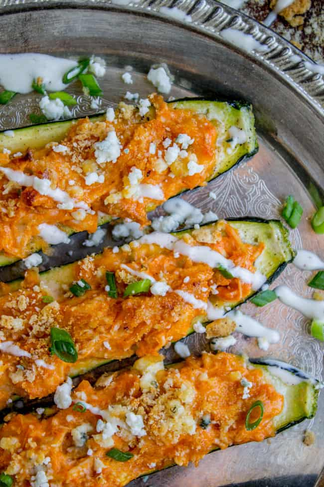Buffalo Chicken Zucchini Boats from The Food Charlatan