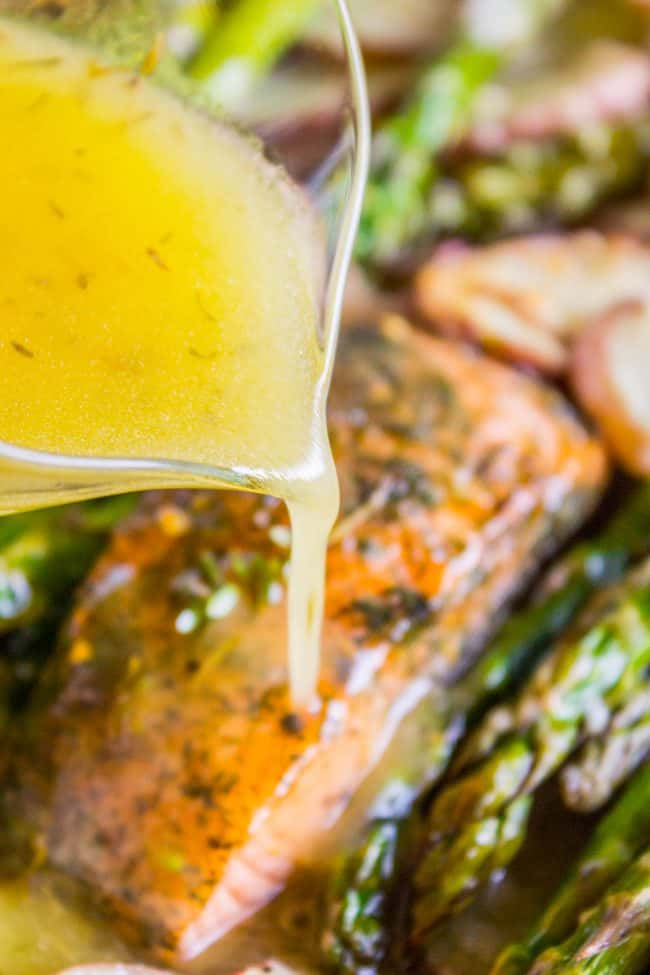 Pouring the citrus glaze onto oven roasted lemon salmon