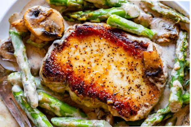 Pan Seared pork chop with mushrooms and asparagus
