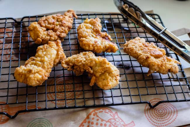 fried chicken cooling on a rack
