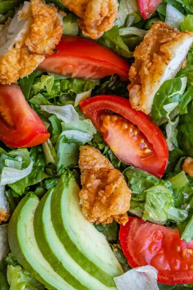 fried chicken salad with tomato and avocado