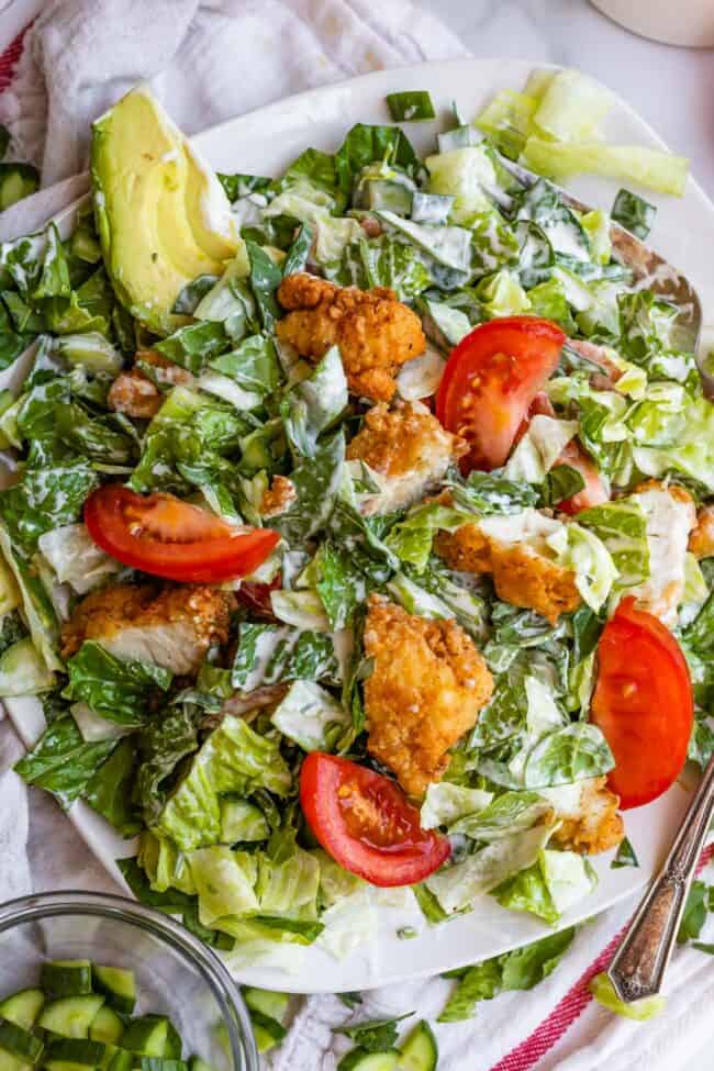 crispy chicken salad on a plate mixed with ranch dressing
