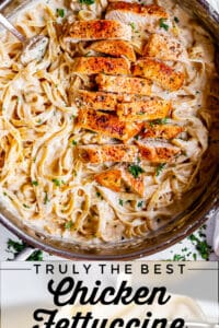 fettucine pasta in a pan with alfredo sauce and chicken