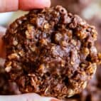 no bake chocolate peanut butter oatmeal cookies held up in hand