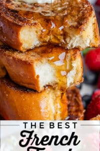 a stack of thick challah french toast with butter and syrup
