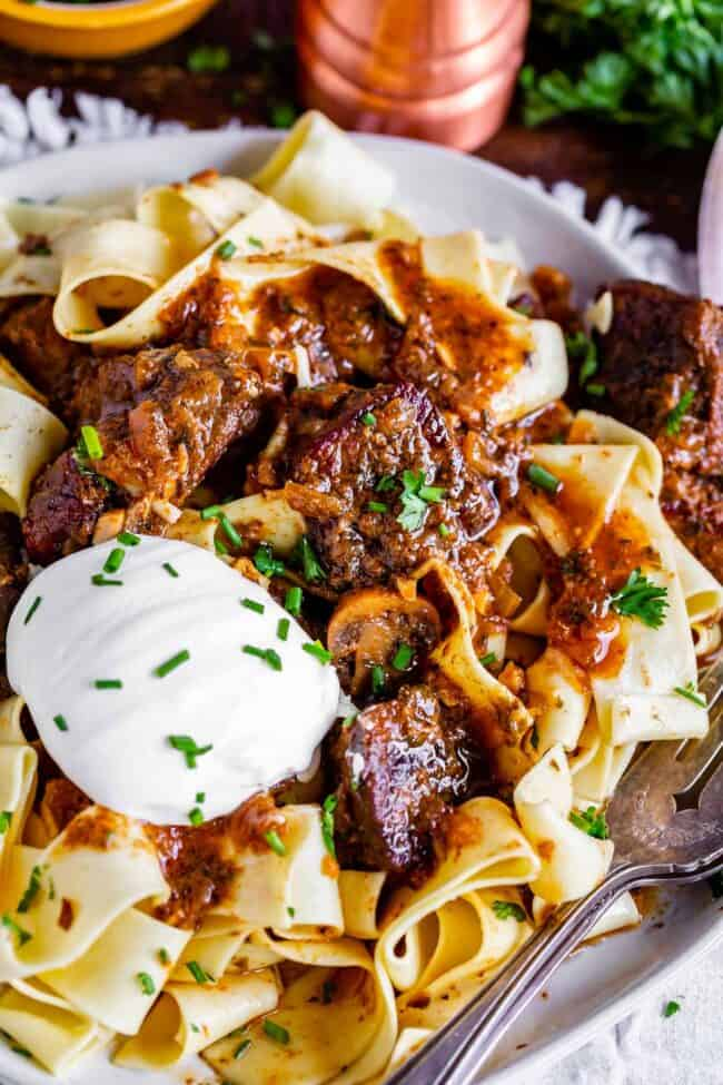 beef stroganoff recipe slow cooker, on a plate with sour cream