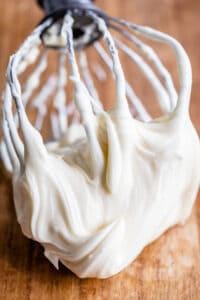 easy cream cheese frosting on a beater on a table