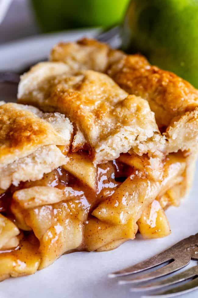 slice of apple pie with homemade flaky pie crust