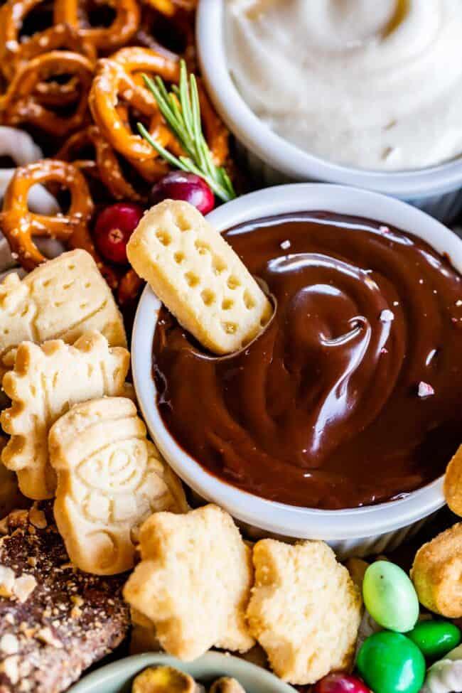 dessert board with chocolate ganache dip, shortbread, and pretzels