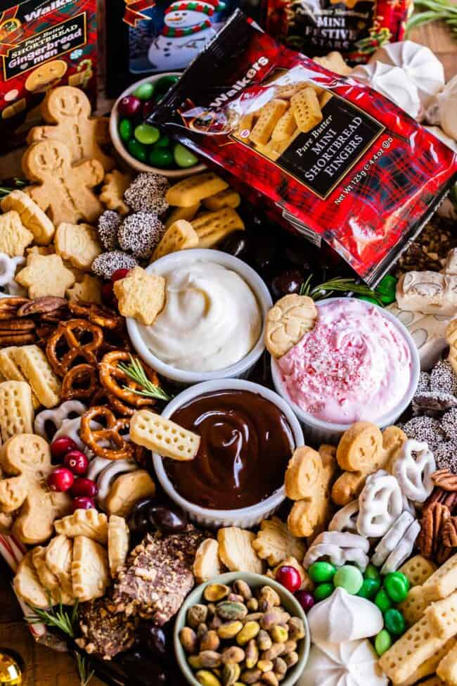 dessert charcuterie on a large board with shortbread, dips, pretzels, toffee, candy