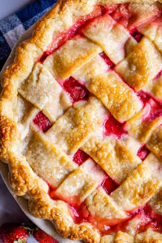 close up overhead shot of strawberry pie with weaved lattice crust