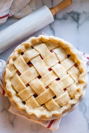 raw lattice pie crust with crimped edges
