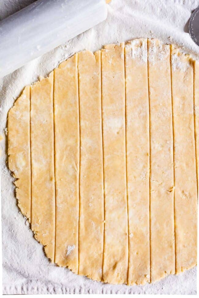 pie dough rolled out and cut into strips for lattice pie crust