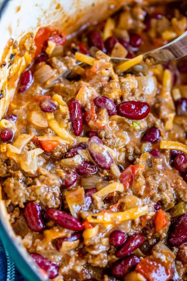 quick chili recipe in a pot mixed with cheese and sour cream