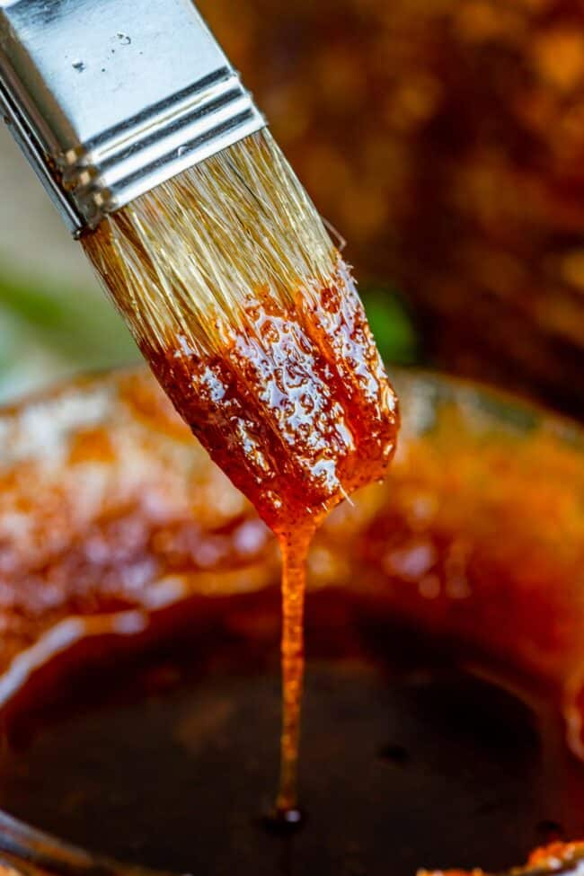 sauce or glaze for ham dripping from a pastry brush