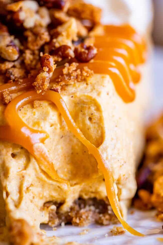 close up shot of a bite taken out of no bake pumpkin cheesecake recipe