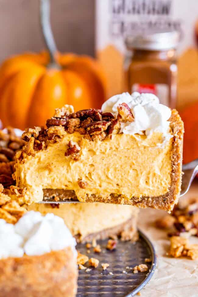 no bake pumpkin cheesecake being lifted from the pan
