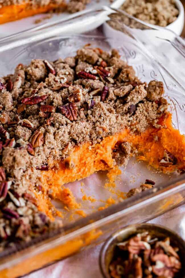pan of sweet potato casserole with some pieces missing