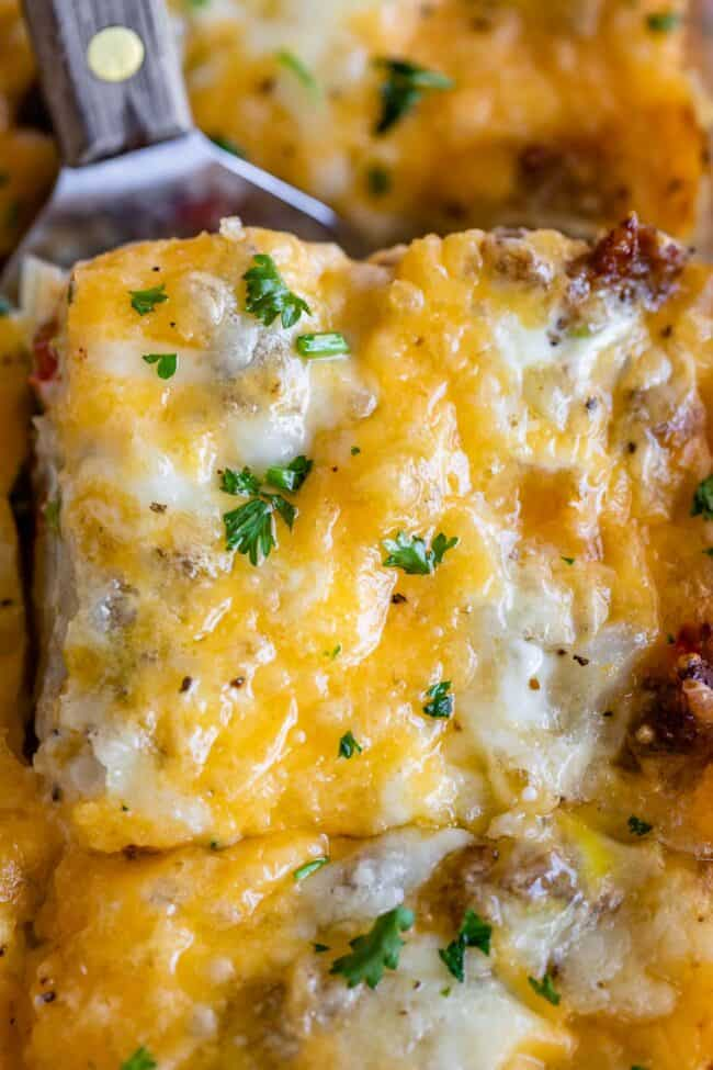 sausage and egg breakfast casserole with parsley sprinkled on top