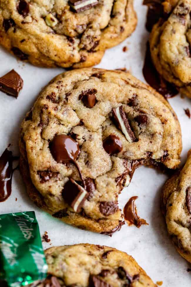 Andes mint cookies on a baking sheet with a bite taken out