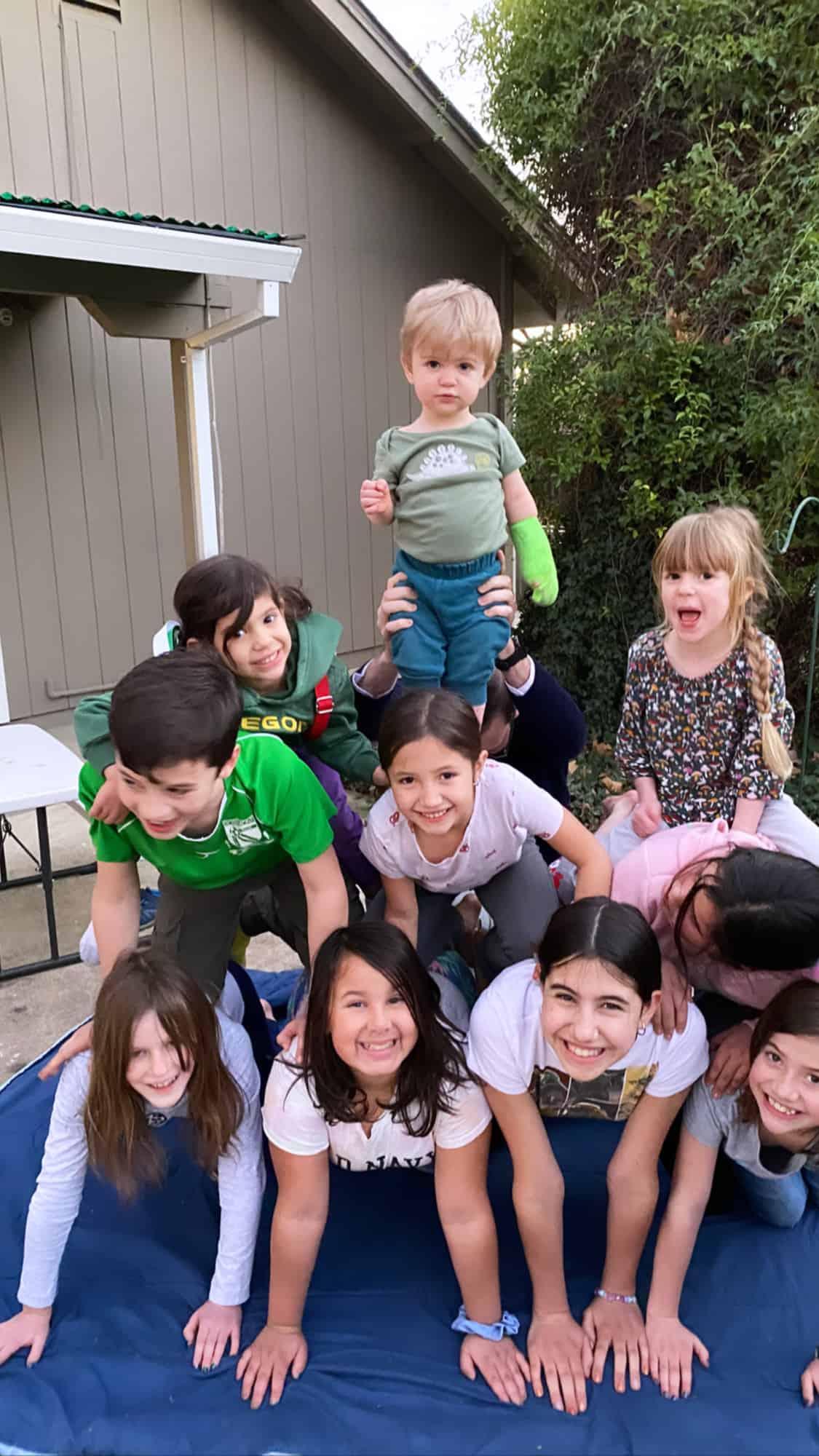 kids making a human pyramid