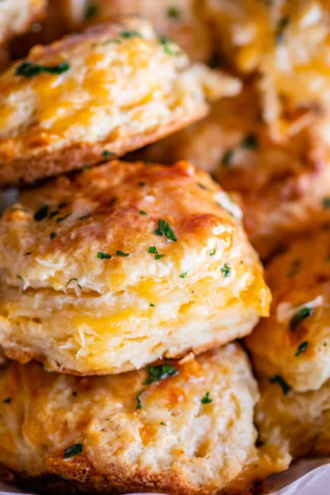cheddar biscuit recipe with several biscuits stacked