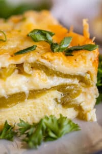 chile relleno breakfast casserole with chopped green onions on a plate