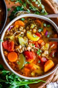 turkey vegetable soup recipe in a bowl on a wooden plate