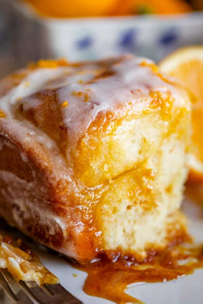 meyer lemon sweet roll on a plate with filling and glaze