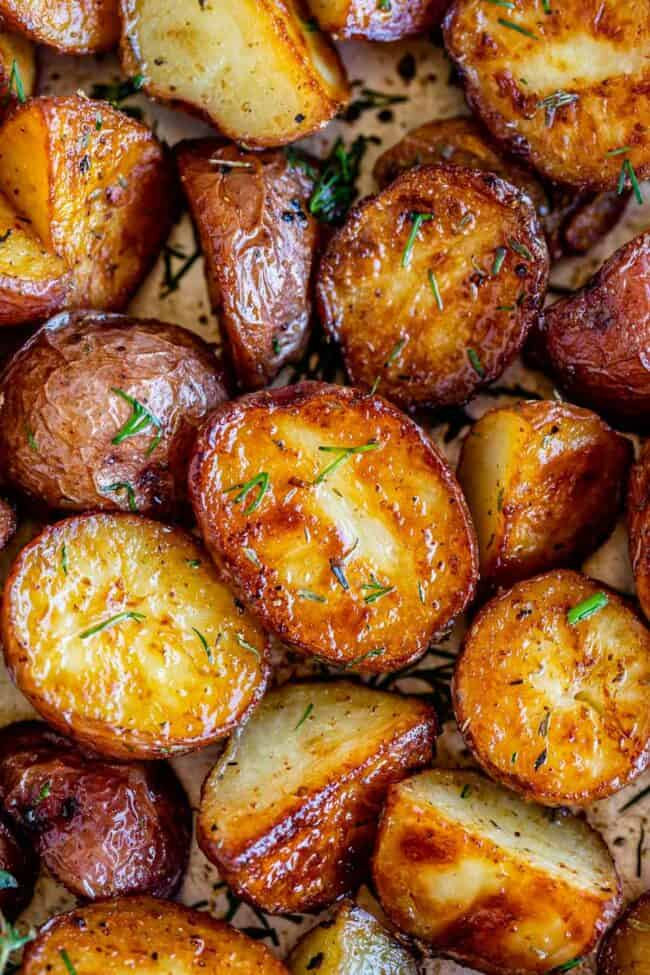 roasted red potatoes recipe on a pan sprinkled with herbs