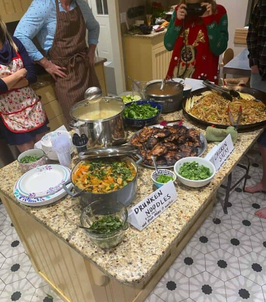 a lot of Thai food set out on a kitchen island