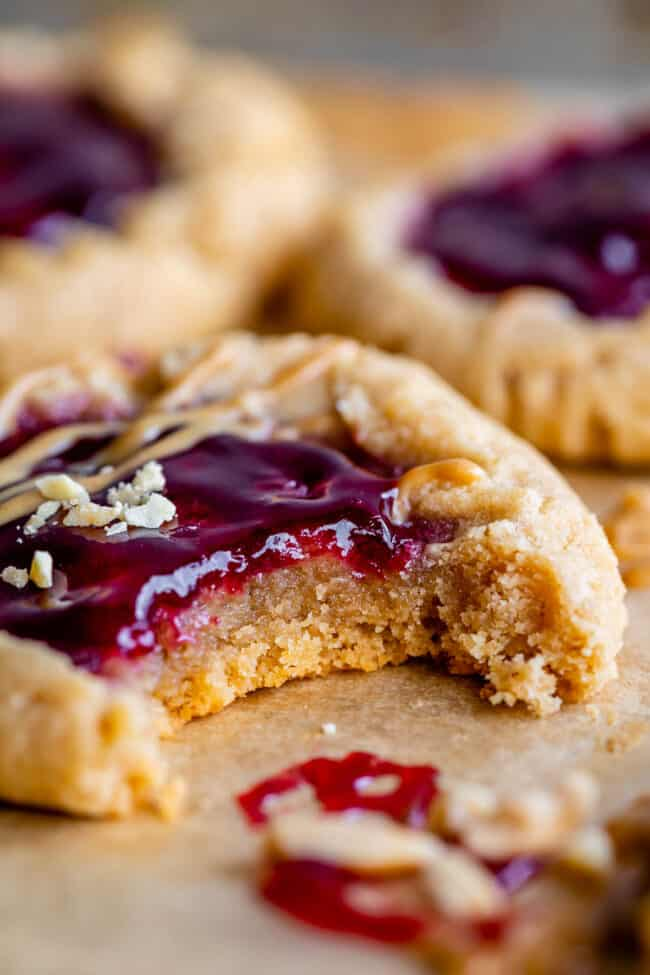 peanut butter jelly cookie with a bite taken out and jam on top