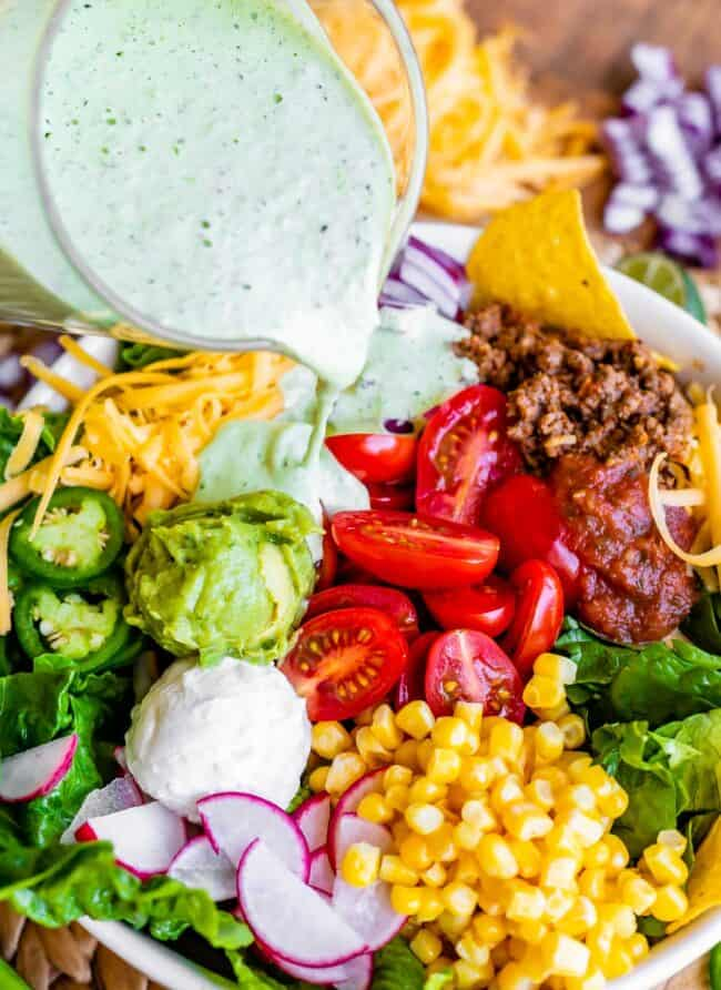 taco salad dressing recipe, pouring dressing