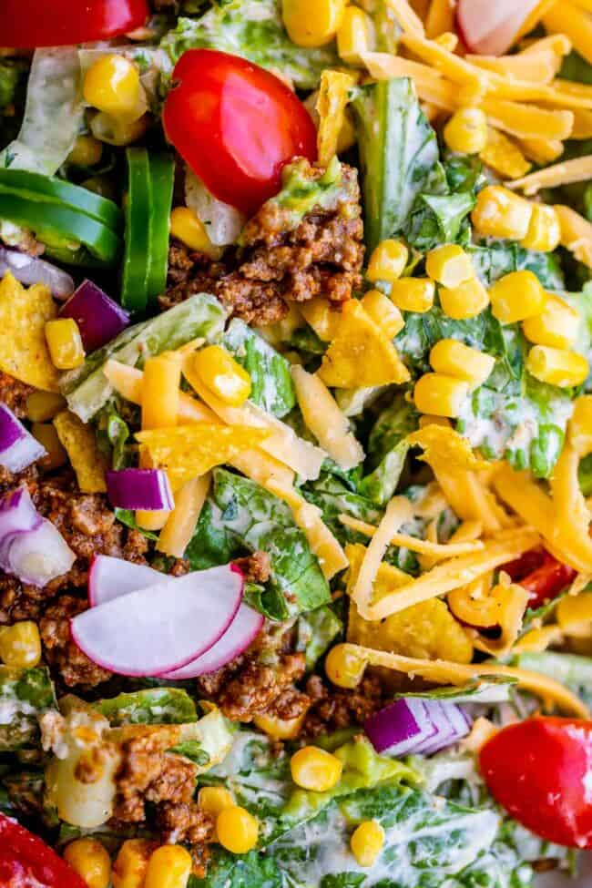 taco salad ingredients mixed together in a bowl